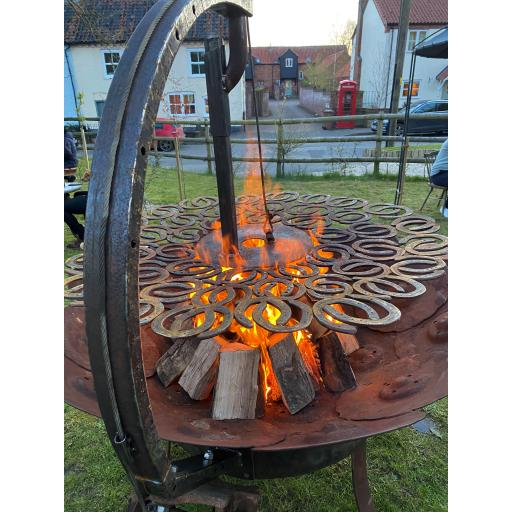 Rose and Crown horse shoe Grill in flame.jpg
